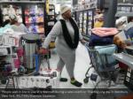 people wait in line to pay at a walmart during