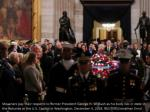 mourners pay their respects to former president