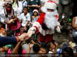richard gamboa hands out sandwiches to children