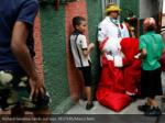 richard gamboa hands out toys reuters marco bello