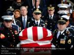 former president george w bush follows the casket