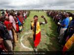 a maasai moran throws a traditional club known