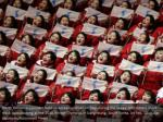 north korean supporters held up korean