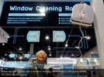 alexander meng looks over a window cleaning robot