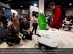 attendees look over pepsico s snackbot robot