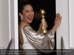 sandra oh poses backstage with her award for best