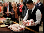 a server places hamburgers on a tray reuters