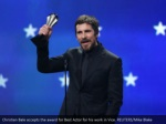 christian bale accepts the award for best actor