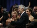 director alfonso cuaron reacts after winning