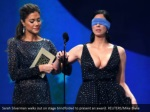 sarah silverman walks out on stage blindfolded
