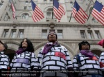 women wear wall protest outfits as they stand