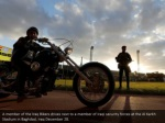 a member of the iraq bikers drives next