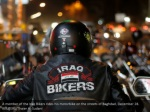 a member of the iraq bikers rides his motorbike