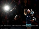 japan s naomi osaka kisses the trophy after