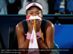 japan s naomi osaka reacts after winning