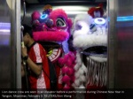lion dance crew are seen in an elevator before
