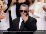 karl lagerfeld blows a kiss to the crowd after