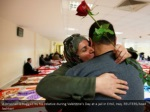 a prisoner is hugged by his relative during