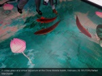 a visitor plays at a virtual aquarium