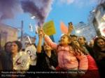 people attend a march marking international women