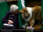a woman kisses her rough collie during the second