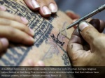 a buddhist monk uses a traditional needle 1