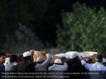 people attend the burial ceremony for the victims