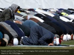 people perform the friday prayers at hagley park