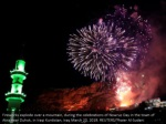 fireworks explode over a mountain during