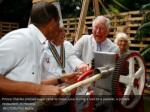 prince charles presses sugar cane to make juice