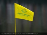 a flag on the 16th hole is shown during the final