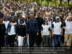 rwandan president paul kagame walks next to other