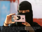 a yemeni woman uses her cellphone to take