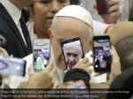 pope francis is framed by cellphones