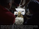 relatives take cellphone pictures of the remains
