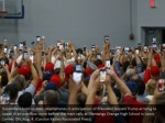 supporters hold up their smartphones
