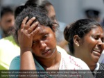 relatives of victims react at a police mortuary
