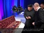 russia s president vladimir putin gives north