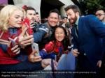 cast member chris evans poses with fans