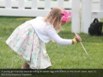 a young girl tries her hand at rolling an easter